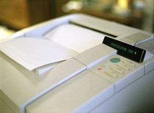 Laser Printer printing out a sheet of paper