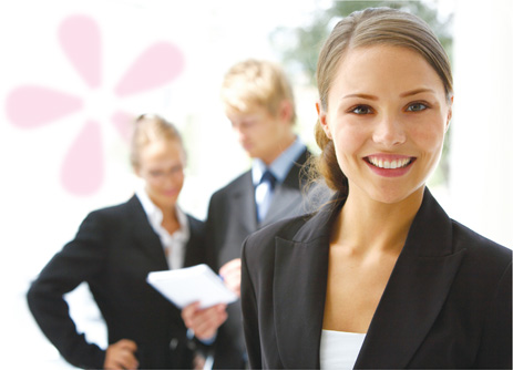 Business woman standing in front of office colleagues